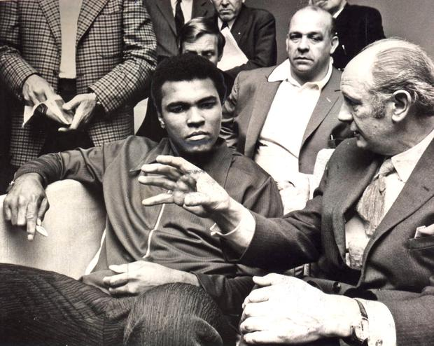 Jack Lynch talking to boxer Muhammad Ali in 1972