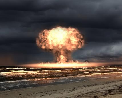 A mushroom cloud caused by a nuclear bomb (stock photo)