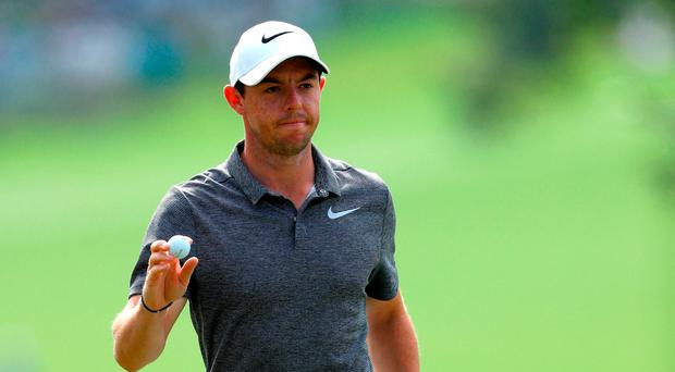 Rory McIlroy reacts to his putt on the 15th hole