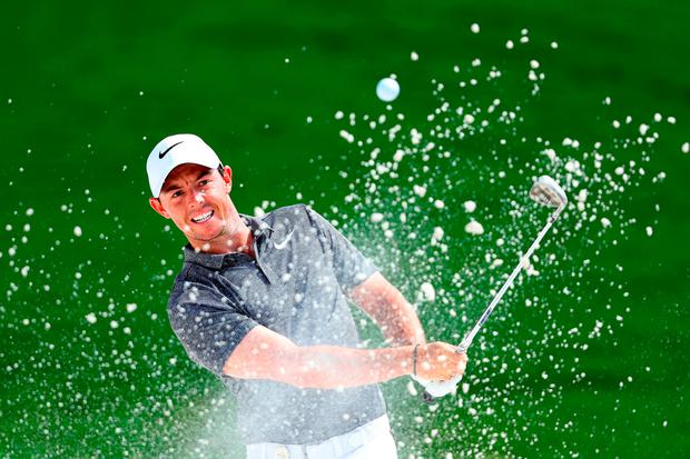 Rory McIlroy plays his shot out of the bunker on the first hole during the second round of the PGA Championship at Quail Hollow. Photo: Warren Little/Getty Images