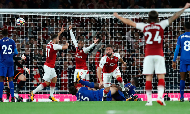 Arsenal's Olivier Giroud scores his side's fourth goal.. Photo: Eddie Keogh/Reuters