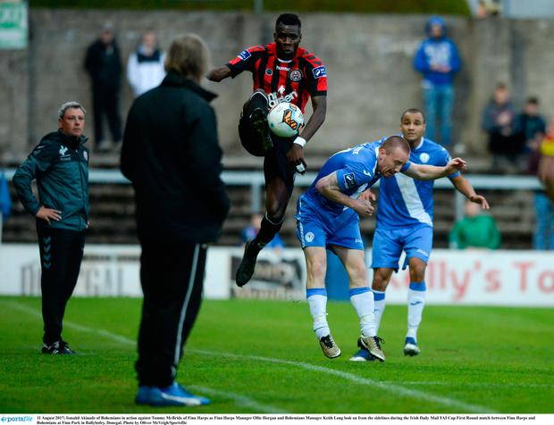Ismahil Akinade of Bohemians in action against Tommy McBride of Finn Harps as Finn Harps Manager Ollie Horgan and Bohemians Manager Keith Long look on from the sidelines during the Irish Daily Mail FAI Cup First Round match between Finn Harps and Bohemians at Finn Park in Ballybofey, Donegal. Photo by Oliver McVeigh/Sportsfile