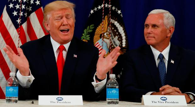 Above: President Donald Trump, flanked by Vice-President Mike Pence, gives a security briefing at his golf estate in Bedminster, New Jersey. Picture: Reuters