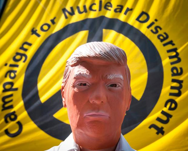 A man wearing a Trump mask takes part in a protest by the Campaign for Nuclear Disarmament at the US Embassy in London to commemorate the anniversary of the Nagasaki nuclear bombing on August 9, 1945. Picture: PA