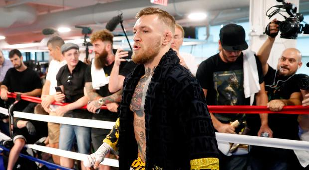Conor McGregor, wearing a Versace robe, warms up in a boxing ring during a workout at the UFC Performance Center in Las Vegas, Nevada, U.S., August 11, 2017. REUTERS/Steve Marcus