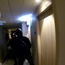 Armed police wait to enter the hotel room of the Irishman