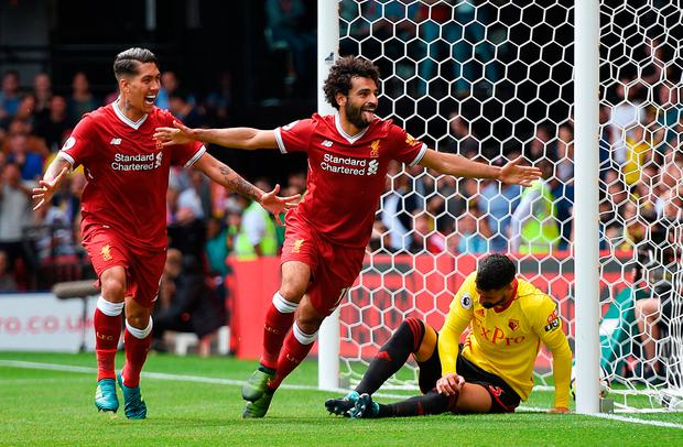 Liverpool's Mohamed Salah celebrates scoring his side's third goal