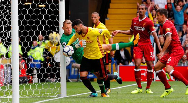 Watford's Miguel Britos scores their third goal