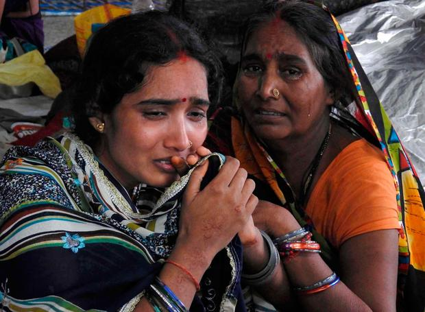 Relatives mourn the death of a child at Baba Raghav Das Medical College Hospital in Gorakhpur, in the northern Indian state of Uttar Pradesh, Saturday, Aug. 12, 2017. (AP Photo)