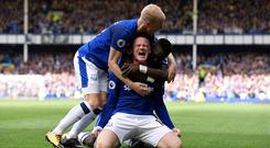LIVERPOOL, ENGLAND - AUGUST 12: Wayne Rooney celebrates his goal with Davy Klaassen (L) and Idrissa Gueye during the Premier League match between Everton and Stoke City at Goodison Park on August 12, 2017 in Liverpool, England. (Photo by Tony McArdle/Everton FC via Getty Images)