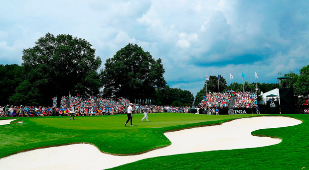 Rory McIlroy, Rickie Fowler and Jon Rahm walk onto the ninth green during the second round of the PGA Championship at Quail Hollow. Photo: Getty Images
