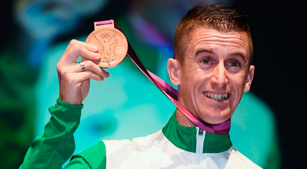 Race walker Robert Heffernan after being presented with the 2012 London Olympic Men's 50km Race Walk Bronze Medal by Willie O'Brien, Acting President of the OCI, at City Hall in Cork. Photo: Sportsfile