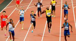 Athletics - World Athletics Championships - Men's 400 Metres Relay Final - London Stadium, London, Britain – August 12, 2017. Nethaneel Mitchell-Blake of Great Britain wins the final as Usain Bolt of Jamaica appears injured. REUTERS/John Sibley