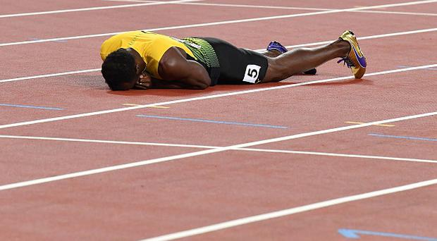 Jamaica's Usain Bolt lies on the track after pulling up injured in the final of the men's 4x100m relay athletics event at the 2017 IAAF World Championships at the London Stadium in London on August 12, 2017. / AFP PHOTO / Andrej ISAKOVIC (Photo credit should read ANDREJ ISAKOVIC/AFP/Getty Images)