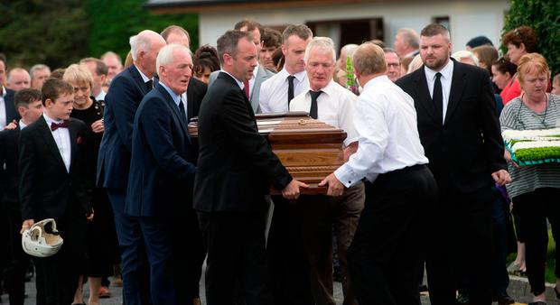 FINAL JOURNEY: The remains of Galway legend Tony Keady arrive at the Church in Oranmore. Photo: Andrew Downes