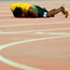 Usain Bolt collapses to the track after pulling up injured during the final leg of the 4x100m relay final at the World Championships in London last night. Photo: Richard Heathcote/Getty Images