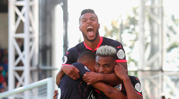 Steve Mounie of Huddersfield Town celebrates scoring his sides third goal with teammates Photo: Getty