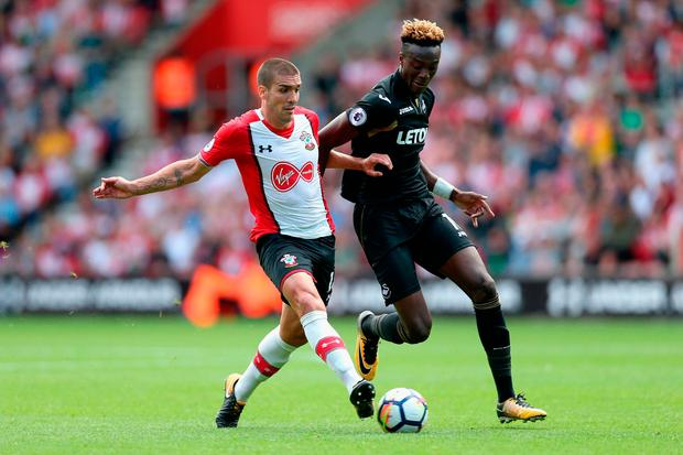 Oriol Romeu of Southampton and Tammy Abraham of Swansea City battle for possession Photo: Getty