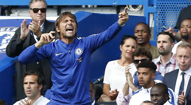 Chelsea's Italian head coach Antonio Conte gestures on the touchline during the English Premier League football match between Chelsea and Burnley at Stamford Bridge in London on August 12, 2017. Burnley won the game 3-2. / AFP PHOTO / Ian KINGTON /Getty Image