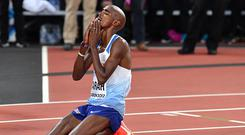 Britain's Mo Farah reacts after finishing second to take silver in the final of the men's 5000m athletics event at the 2017 IAAF World Championships at the London Stadium in London on August 12, 2017. / AFP PHOTO / Andrej ISAKOVIC/Getty Images