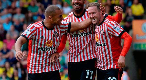 Sunderland's Aiden McGeady (right) celebrates scoring his team's second goal with James Vaughan (left) and Lewis Grabban (centre)