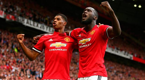 Manchester United's Romelu Lukaku, right, celebrates with Manchester United's Marcus Rashford after scoring his side's first goal