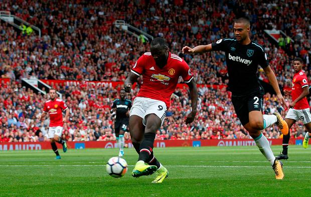 Manchester United's Romelu Lukaku scores their first goal