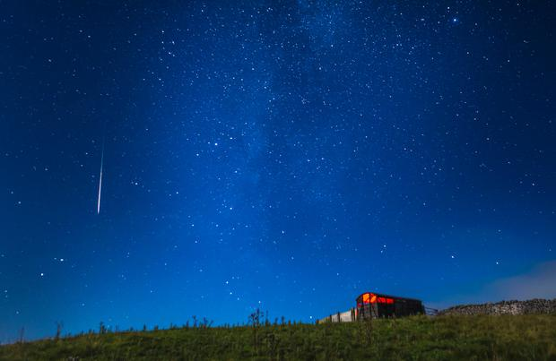 A meteor during the Perseid meteor shower seen from near Hawes in the Yorkshire Dales National Park, as the Earth flies through a cloud of cometary dust creating a spectacular display of celestial fireworks. Photo: Danny Lawson/PA Wire
