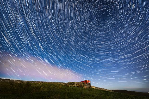 Digital composite of 30 photographs taken over a period of 15 minutes of meteor and star trails during the Perseid meteor shower seen from near Hawes in the Yorkshire Dales National Park. Photo: Danny Lawson/PA Wire