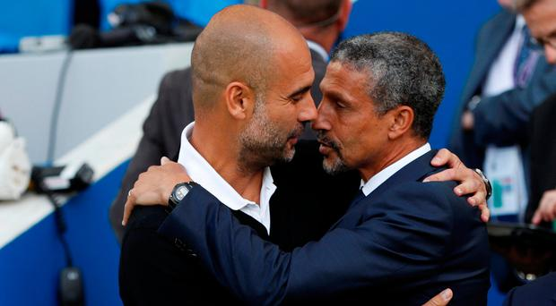 Pep Guardiola and Chris Hughton exchange pleasantaries before Manchester City's victory over Brighton. Photo: Reuters/Paul Childs