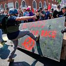 "White nationalists, neo-Nazis and members of the ""alt-right"" clash with counter-protesters in Charlottesville, Virginia. Photo: Getty Images"