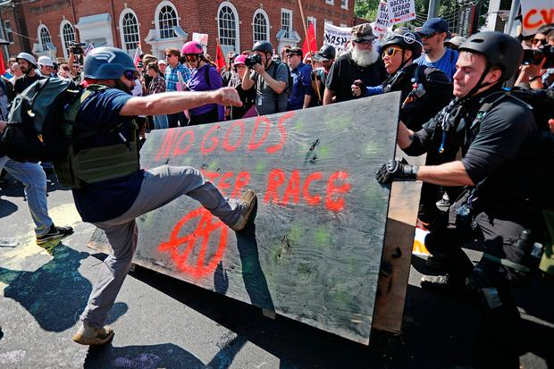 """White nationalists, neo-Nazis and members of the """"alt-right"""" clash with counter-protesters in Charlottesville, Virginia. Photo: Getty Images"""