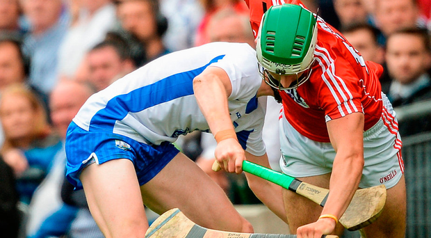 Shane Kingston of Cork is tackled by Kieran Bennett of Waterford during the GAA Hurling All-Ireland Senior Championship Semi-Final match between Cork and Waterford at Croke Park in Dublin. Photo: Sportsfile