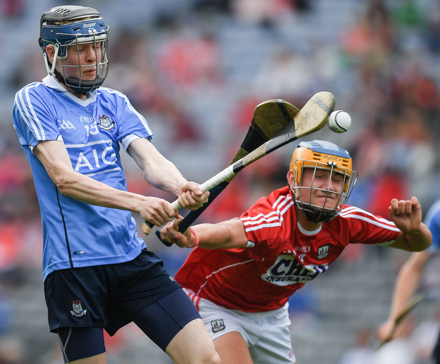Luke McDwyer of Dublin in action against Eoin Roche of Cork during the Electric Ireland GAA Hurling All-Ireland Minor Championship Semi-Final match between Dublin and Cork at Croke Park in Dublin. Photo: Sportsfile