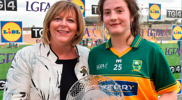 Hannah O'Donoghue of Kerry is presented with her player of the match award by LGFA President Marie Hickey after the TG4 Ladies Football All-Ireland Senior Championship Quarter-Final match between Kerry and Armagh at Nowlan Park in Kilkenny. Photo: Sportsfile