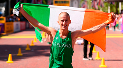 Rob Heffernan holds the tricolour aloft after what looks likely to have been his final race. Photo by Stephen McCarthy/Sportsfile