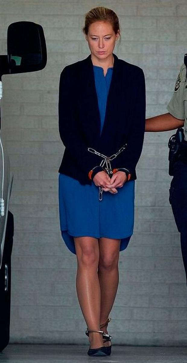 Molly Martens-Corbett being led away in chains to begin her sentence. Photo: Donnie Roberts