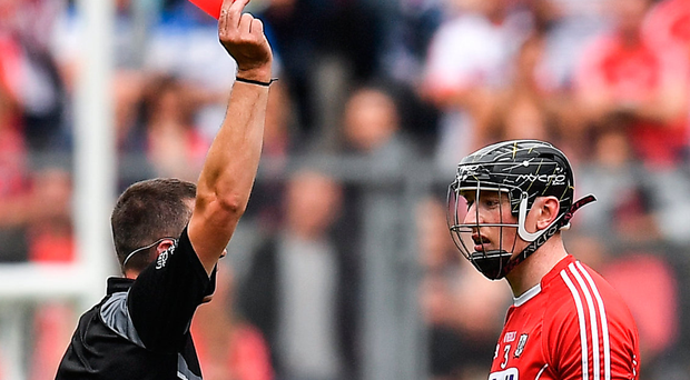 Cork's Damian Cahalane is shown a red card by referee James Owens yesterday. Photo: Sportsfile