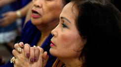 Local residents pray during a Sunday Mass at Sta Barbara Church on the island of Guam. Photo: REUTERS