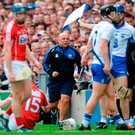Waterford manager Derek McGrath running up the sideline after the incident in which Luke Meade (Cork No 15) clashed with Austin Gleeson (not in picture) and had his helmet removed. Photo: Sportsfile