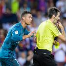 BARCELONA, SPAIN - AUGUST 13: Cristiano Ronaldo of Real Madrid (L) gets a red card from Fifa Referee Ricardo de Burgos Bergoetxea (R) during the Supercopa de Espana Final 1st Leg match between FC Barcelona and Real Madrid at Camp Nou on August 13, 2017 in Barcelona, Spain. (Photo by Power Sport Images/Getty Images)