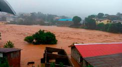 In this image made available by Society 4 Climate Change Communication, Sierra Leone, mud and water flow in Freetown Sierra Leone ( Society 4 Climate Change Communication via AP)