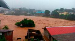 In this image made available by Society 4 Climate Change Communication, Sierra Leone, mud and water flow in Freetown Sierra Leone Monday Aug. 14, 2017. ( Society 4 Climate Change Communication via AP)