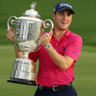 Justin Thomas lifts the Wanamaker trophy after breaking his Major duck. Photo: USA Today Sports