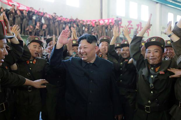 North Korean leader Kim Jong-Un (C) celebrating the successful test-fire of the intercontinental ballistic missile Hwasong-14 at an undisclosed location. Photo: STR/AFP/Getty Images