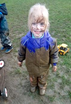 Millie McClinton enjoying getting covered in muck. Photo: Séamus Farrelly