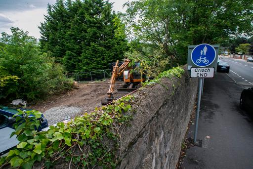 The scene at the site of the search for Mr Deely's remains near the Liffey off the Old Lucan Road in Chapelizod. Photo: Kyran O'Brien