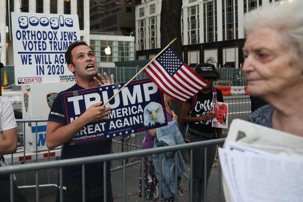 A supporter of U.S. President Donald Trump shouts as people pass during protests ahead of his arrival in Manhattan, New York, U.S., August 14, 2017. REUTERS/Shannon Stapleton