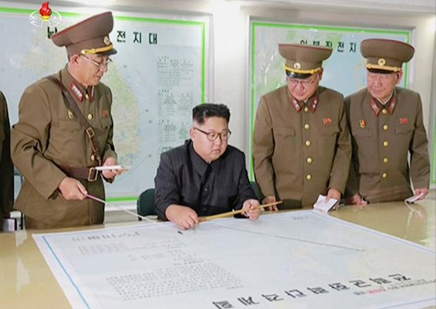 This image made from video of an Aug. 14, 2017, still image broadcast in a news bulletin on Tuesday, Aug. 15, 2017, by North Korea's KRT shows North Korean leader Kim Jong Un receiving a briefing in Pyongyang. (KRT via AP Video)