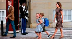 Danish Crown Prince Frederik (L) and Crown Princess Mary (R) are pictured with their twins Prince Vincent (Center R) and Princess Josephine (Center L) in front of Amalienborg Castle in Copenhagen on the sibling's first day of school on August 15, 2017
